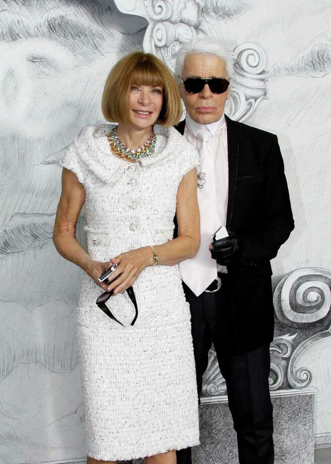 Fashion designer Karl Lagerfeld, right, and editor-in-chief of American Vogue Anna Wintour arrive for the Chanel Women's Fall Winter 2013 haute couture fashion collection in Paris, France, Tuesday, July 3, 2012. Photo: Francois Mori, AP / AP