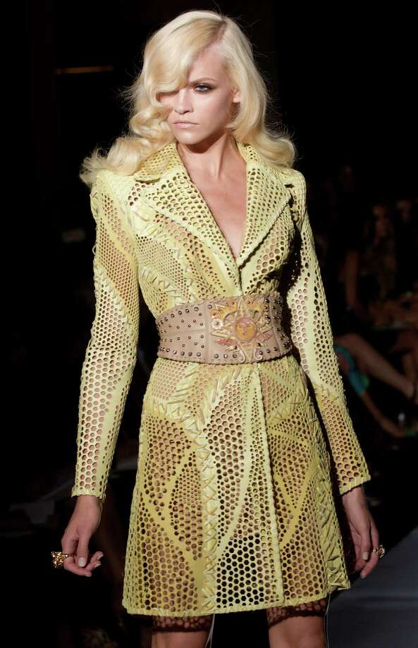 A model wears a creation by fashion designer Donatella Versace during her Women's Fall Winter 2013 haute couture fashion collection, for fashion house in Paris, France, Sunday, July 1, 2012. Photo: Jacques Brinon, AP / AP