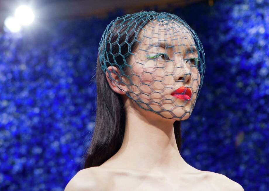 A model wears a creation by fashion designer Raf Simons for Dior, during his Women's Fall Winter 2013 haute couture fashion collection, during fashion week in Paris, France, Monday, July 2, 2012. Photo: Jacques Brinon, AP / AP