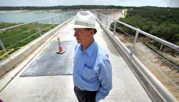 Bexar County Judge Nelson Wolff stands on Medina Lake Dam which was questioned for it's structural integrity in 2002 during the flood.  Monday, July 2, 2012. Photo: BOB OWEN, San Antonio Express-News / © 2012 San Antonio Express-News