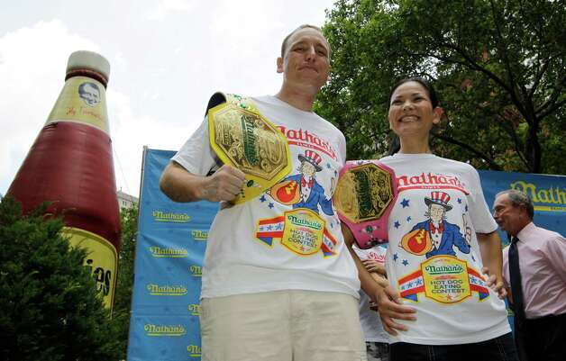 "Five-time hot dog-eating world champion Joey Chestnut and women's record-holder Sonya ""The Black Widow"" Thomas compete today. Photo: AP"