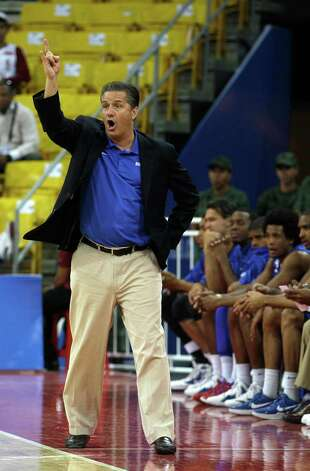 John Calipari gives direction to his Dominican Republic team at an Olympic qualifier in Venezuela during a 95-85 win over South Korea. Photo: AP
