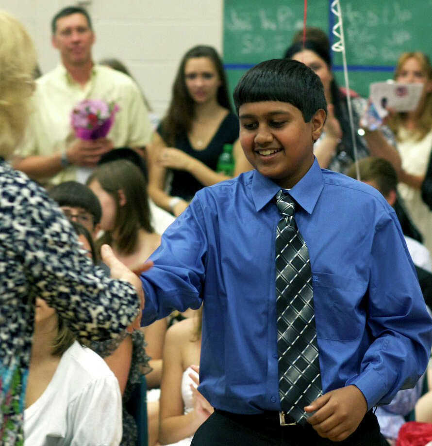 Aakash Parikh is justifiably all smiles as he collects awards including Outstanding Student in Science, Outstanding Achievement in Math, the Cabe Scholars and perfect attendance for five years during Team Red and Team Blue's promotion ceremony at Schaghticoke Middle School in New Milford. June 18, 2012 Photo: Trish Haldin