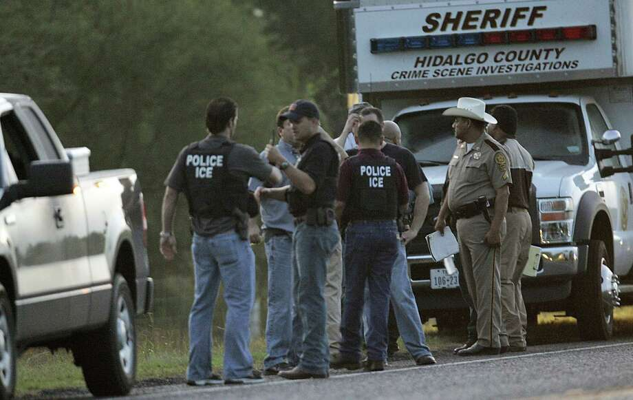 Enforcement Agents, Hidalgo County Sheriff Deputies and other law enforcement gather at the scene early Tuesday, July 3, 2012 where an ICE Agent was shot near Hargill, Texas. The agent with ICE's Homeland Security Investigations was shot early Tuesday near Hargill, about 25 miles northeast of McAllen. The agent was conducting surveillance related to an ongoing criminal investigation, ICE spokeswoman Nina Pruneda said. The agent was taken to a local hospital and was undergoing surgery, she said. (AP Photo/The Monitor, Delcia Lopez)  MAGS OUT. TV OUT Photo: AP
