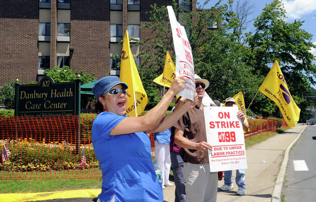 Workers at Danbury Health Care Center on Osborne Street in Danbury went on strike at 6 a.m. Wednesday, July 3, 2012, and are protesting outside the health care facility. This is one of five in the state owned by HealthBridge - all on strike. Photo: Carol Kaliff