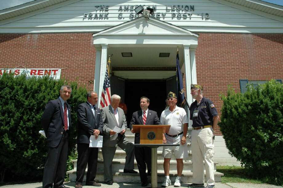 State Sen. Bob Duff (D-Norwalk), center, speaks about new veterans programs at an event at the American Legion in Norwalk Tuesday. Joining  him are from left, state Sen. Carl Leone (D-Stamford), House Minority Leader Larry Cafero, (R-Norwalk); Norwalk Mayor Richard Moccia; American Legion Post 12 Commander Buddy Scudder, and Phillip Kraft, president of the National Veterans Service Fund. Photo: Contributed Photo