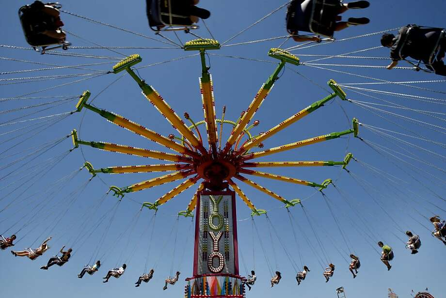 The YoYo ride at the Marin Fair covered the blue sky. The 2012 Marin County Fair concludes Wednesday July 4th, and many chose the day before to take in the exhibits, animals and rides on a picturesque summer day. Photo: Brant Ward, The Chronicle