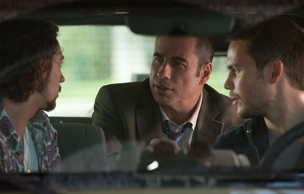 (L to R) Ben (AARON JOHNSON), DEA agent Dennis (JOHN TRAVOLTA) and Chon (TAYLOR KITSCH) in