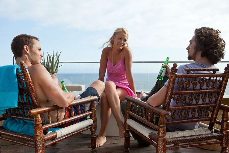 "(L to R) Chon (TAYLOR KITSCH), O (BLAKE LIVELY) and Ben (AARON JOHNSON) in ""Savages"", the ferocious thriller from three-time Oscar¨-winning filmmaker Oliver Stone that features the all-star ensemble cast of Kitsch, Lively, Johnson, John Travolta, Benicio Del Toro, Salma Hayek, Emile Hirsch and Demi‡n Bichir. Photo: Francois Duhamel, Universal Pictures"
