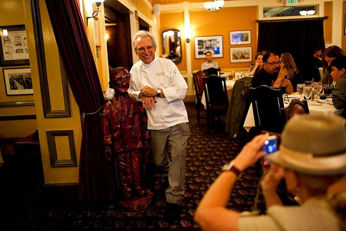 Head chef Gianni Audieri poses in front of a wooden sculpture of himself at Fior D'Italia restaurant in San Francisco, Calif., May 21, 2012. Jason Henry/Special to The Chronicle