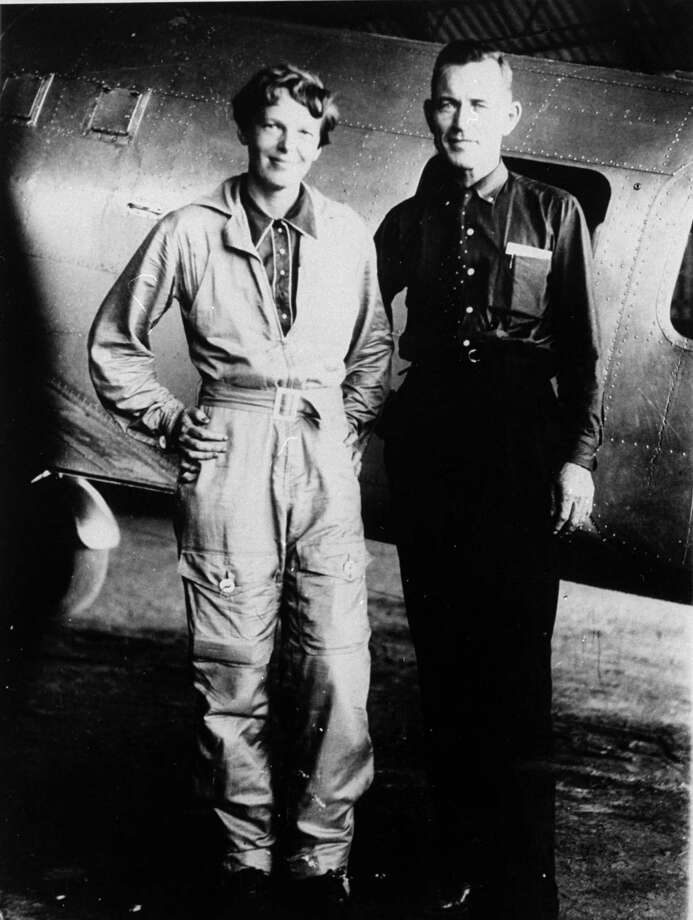 FILE-- In a 1937 file photo aviator Amelia Earhart and her navigator, Fred Noonan, pose in front of their twin-engine Lockheed Electra in Los Angeles prior to their historic flight in which Earhart was attempting to become first female pilot to circle the globe.  A $2.2 million expedition is hoping to finally solve one of America's most enduring mysteries. What happened to famed aviator Amelia Earhart when she went missing over the South Pacific 75 years ago? (AP Photo, File) / AP2007
