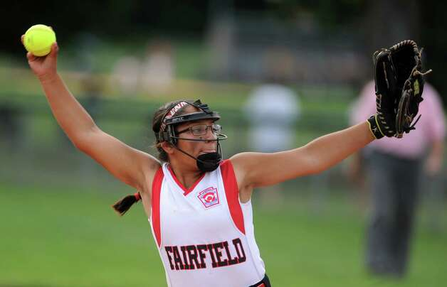 Fairfield's Brittany Romero pitches to Black Rock during the District 2 Little League softball championship Tuesday, July 3, 2012 at Unity Park in Trumbull, Conn. Photo: Autumn Driscoll / Connecticut Post