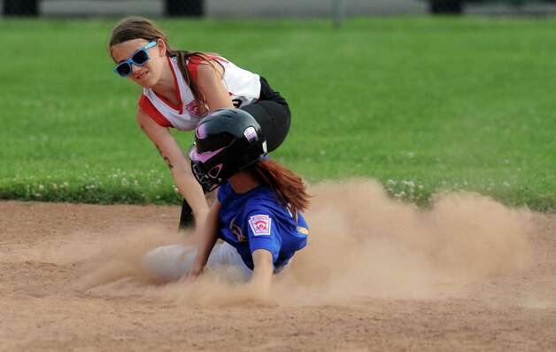 Fairfield's Amanda Schramm tags Black Rock's Jasmine Rivera at second base during the District 2 Little League softball championship Tuesday, July 3, 2012 at Unity Park in Trumbull, Conn. Photo: Autumn Driscoll / Connecticut Post