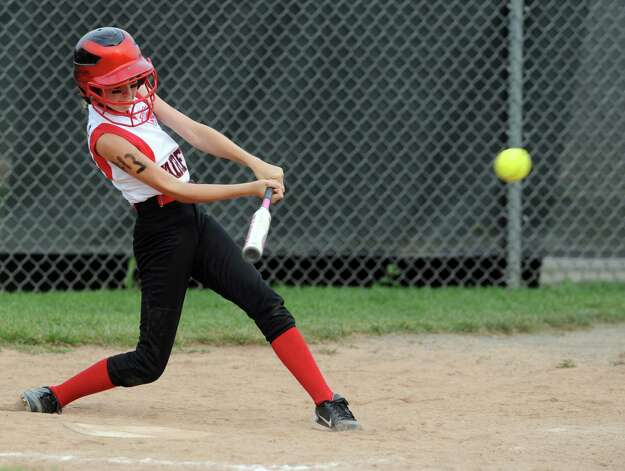 Fairfield's Michaela O'Donnell gets a hit during the District 2 Little League softball championship game against Black Rock Tuesday, July 3, 2012 at Unity Park in Trumbull, Conn. Photo: Autumn Driscoll / Connecticut Post