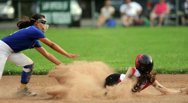 Fairfield's Zoe Holderied steals second base as Black Rock's Nene Capeles tries to reach her during the District 2 Little League softball championship Tuesday, July 3, 2012 at Unity Park in Trumbull, Conn. Photo: Autumn Driscoll / Connecticut Post