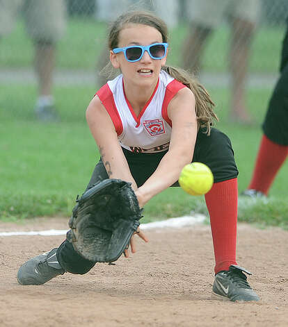 Fairfield plays Black Rock in the District 2 Little League softball championship Tuesday, July 3, 2012 at Unity Park in Trumbull, Conn. Photo: Autumn Driscoll / Connecticut Post