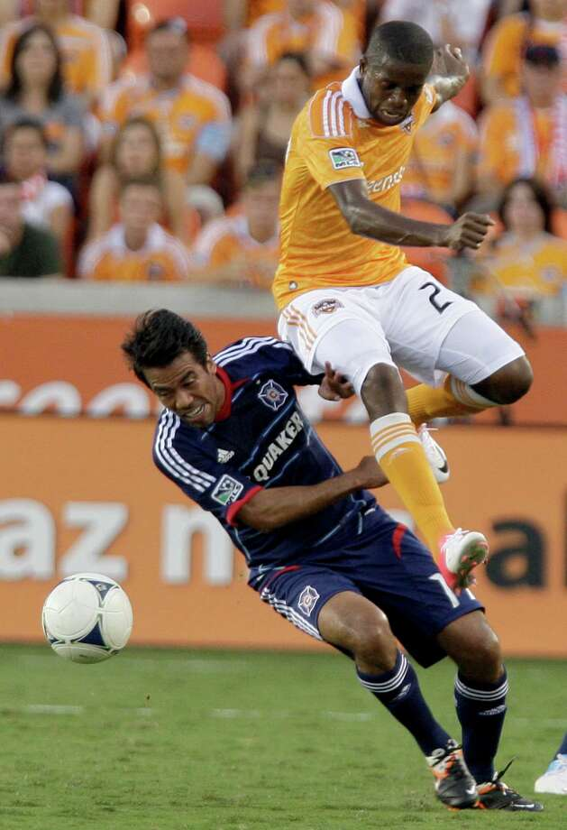 Houston Dynamo Boniek Garcia (27) leaps over Chicago Fire midfielder Pavel Pardo. Photo: Thomas B. Shea, For The Chronicle / © 2012 Thomas B. Shea