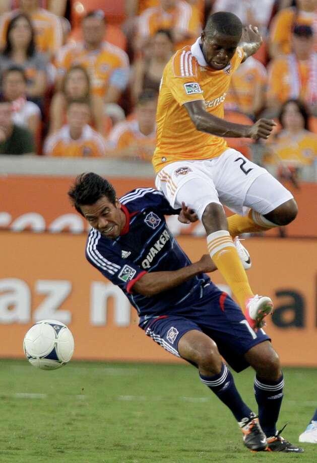 Houston Dynamo Boniek Garcia (27) leaps over Chicago Fire midfielder Pavel Pardo. Photo: Thomas B. Shea, For The Chronicle / © 2012 Thomas B. Shea