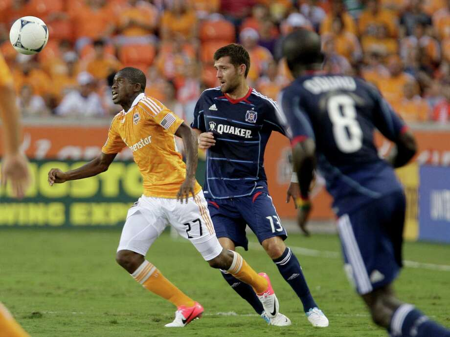 7/3/12: Houston Dynamo Boniek Garcia (27) heads the ball away from Chicago Fire midfielder Pavel Pardo (17) at BBVA Compass Stadium in Houston, Texas. Photo: Thomas B. Shea, For The Chronicle / © 2012 Thomas B. Shea