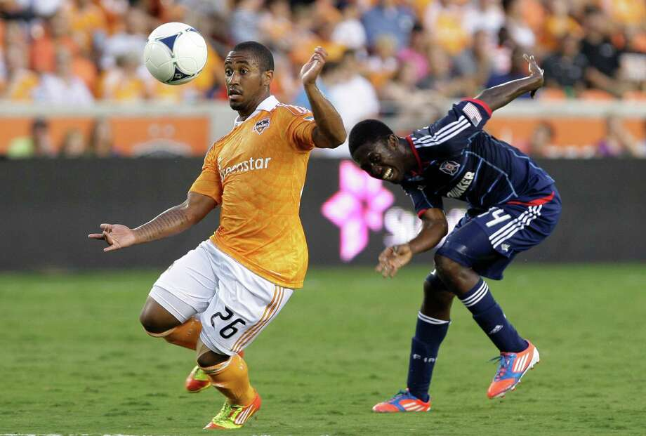 7/3/12:  Houston Dynamo midfielder Corey Ashe (26) heads the ball away from Chicago Fire forward Patrick Nyarko (14)  at BBVA Compass Stadium in Houston, Texas. Photo: Thomas B. Shea, For The Chronicle / © 2012 Thomas B. Shea