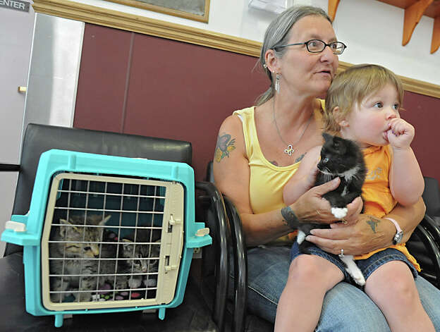 Sue Beaudette of Schenectady, who is a foster mom for cats, waits in the lobby with her granddaughter Jadyn Sanzo, age 11/2, at the Animal Protective Foundation Tuesday, July 3, 2012 in Glenville, N.Y. Lately, the shelter has been full or near full capacity. (Lori Van Buren / Times Union) Photo: Lori Van Buren