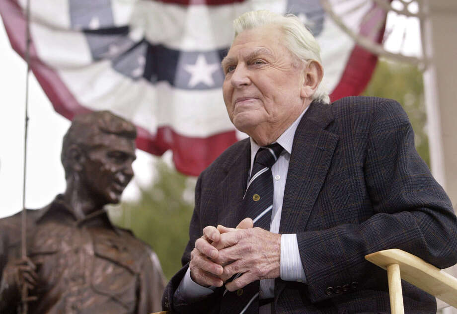 """FILE - This Oct. 28, 2003 file photo shows actor Andy Griffith sitting in front of a bronze statue of Andy and Opie from the """"Andy Griffith Show,"""" after the unveiling ceremony in Raleigh, N.C.  Griffith, whose homespun mix of humor and wisdom made """"The Andy Griffith Show"""" an enduring TV favorite, died Tuesday, July 3, 2012 in Manteo, N.C. He was 86. (AP Photo/Bob Jordan, File) Photo: BOB JORDAN"""