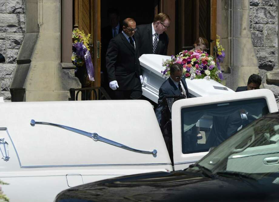 Pall bearers bring the casket carrying the remains of Ashton Jojo , 11 from her funeral service at the Jermain Memorial Ecumenical Presbyterian Church in Watervliet, N.Y. July 3, 2012.  Jojo lost her life while vacationing in Orlando with her family.  (Skip Dickstein/Times Union) Photo: Skip Dickstein / 00018323A