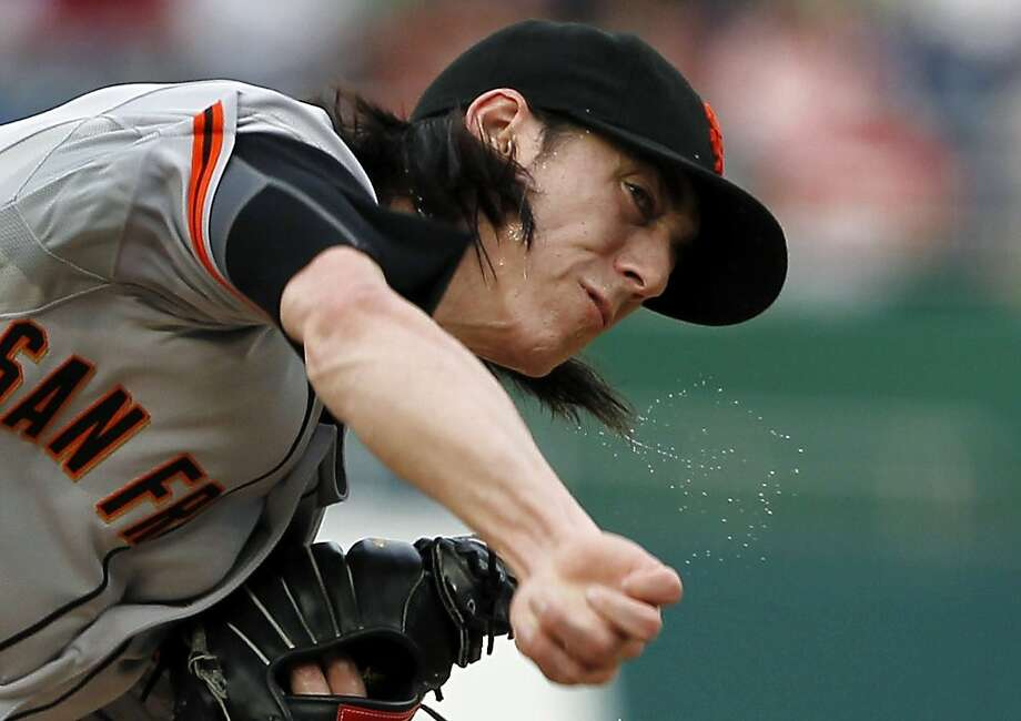 Sweat flies off San Francisco Giants starting pitcher Tim Lincecum as he throws during the first inning of a baseball game with the Washington Nationals, Tuesday, July 3, 2012, in Washington. (AP Photo/Alex Brandon) Photo: Alex Brandon, Associated Press