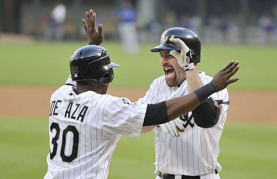 CHICAGO, IL- JULY 3:  Alejandro De Aza #30 of the Chicago White Sox (L) greets teammate Kevin Youkilis #20 at home plate after Youkilis hit a two-run home run scoring De Aza during the first inning against the Texas Rangers on July 3, 2012 at U.S. Cellular Field in Chicago, Illinois.  (Photo by Brian Kersey/Getty Images) Photo: Brian Kersey, Getty Images
