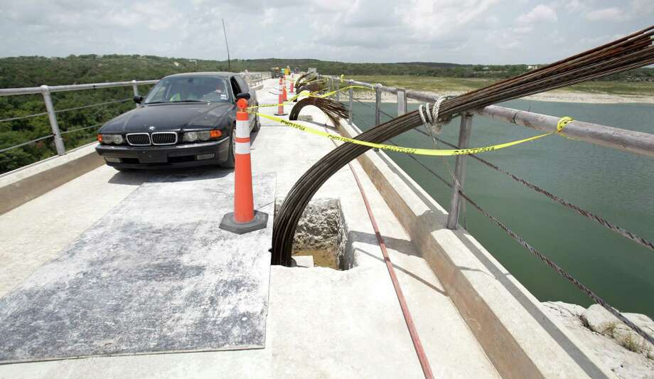 Philip Brant, drives across the Medina Lake Dam which, is the only way to his house on the west side of the lake.  reinforcing the structure, Monday, July 2, 2012. Photo: BOB OWEN, San Antonio Express-News / © 2012 San Antonio Express-News