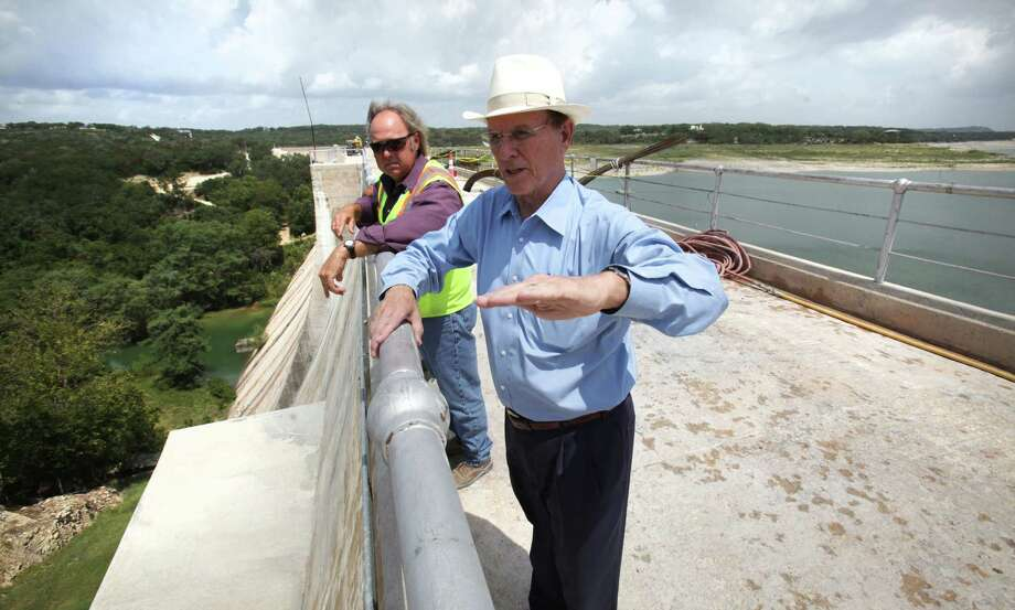 Bexar County Judge Nelson Wolff, right, and Kris Roberson, Senior Engineering Technician for San Antonio River Authority, discuss repairs to the Medina Lake Dam which is reinforcing the structure, Monday, July 2, 2012. Photo: BOB OWEN, San Antonio Express-News / © 2012 San Antonio Express-News
