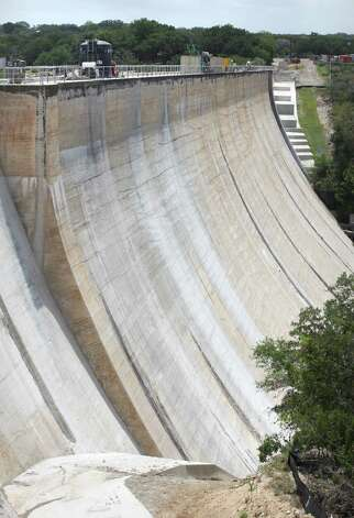 "The construction project at the Medina Lake Dam is reinforcing the structure, with 33 ""anchors"" which tie the top of the dam, through the structure, all the way down into the bedrock below the dam.  Monday, July 2, 2012. Photo: BOB OWEN, San Antonio Express-News / © 2012 San Antonio Express-News"