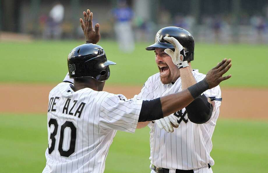 A laugher for one team was a major bummer for the opposition as the White Sox feasted on Rangers pitching in a 19-2 victory.  The fun for Chicago started in the first inning as Alejandro De Aza welcomed Kevin Youkilis after Youkilis' two-run homer. It was one of three homers in the inning off Texas starter Roy Oswalt, right, who was roughed up for 11 runs in 42⁄3 innings. Photo: Brian Kersey / 2012 Getty Images