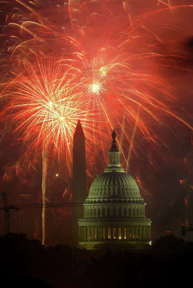 Fourth of July fireworks explode in the sky behind the U.S. Capitol and Washington Monument, Sunday, July 4, 2004, in Washington. Photo: LAWRENCE JACKSON, AP / AP