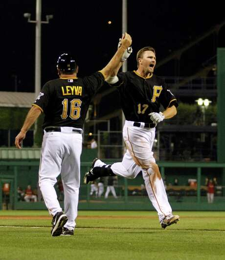 The Pirates' Drew Sutton glides around the bases after ending Tuesday's game with a homer. Photo: Justin K. Aller / 2012 Getty Images