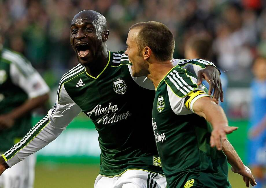 PORTLAND, OR - JULY 03:  Jack Jewsbury #13 of the Portland Timbers celebrates his 2nd half goal with Mamadou Danso #98 against the San Jose Earthquakes on July 3, 2012 at Jeld-Wen Field in Portland, Oregon.  (Photo by Jonathan Ferrey/Getty Images) Photo: Jonathan Ferrey, Getty Images