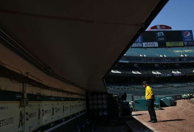 A security guard stands watch over the field after the Oakland A's game against the Blue Jays in Oakland, Calif., Wednesday, May 9, 2012. Photo: Sarah Rice, Special To The Chronicle