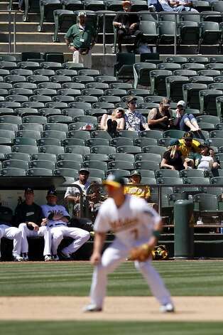 Fans watch the Oakland A's game against the Blue Jays in Oakland, Calif., Wednesday, May 9, 2012. Photo: Sarah Rice, Special To The Chronicle