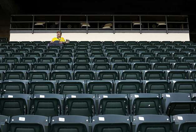 Rolland Hamilton, of Walnut Creek, has his section to himself during the Oakland A's game against the Blue Jays in Oakland, Calif., Tuesday, May 8, 2012.  Hamilton said he's had season tickets to the A's for about 25 years. Photo: Sarah Rice, Special To The Chronicle