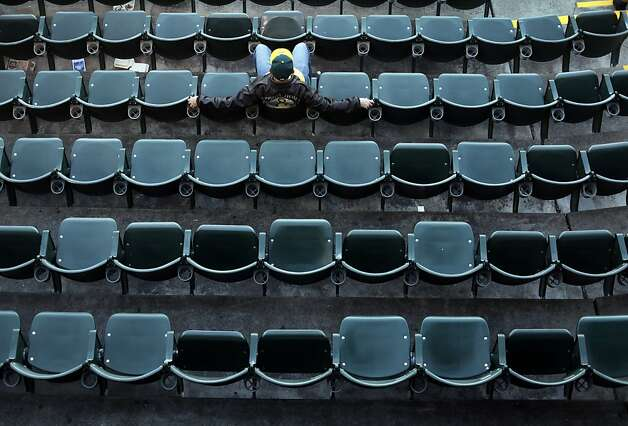 Fans have plenty of room to stretch out during the Oakland A's game against the Blue Jays in Oakland, Calif., Tuesday, May 8, 2012. Photo: Sarah Rice, Special To The Chronicle