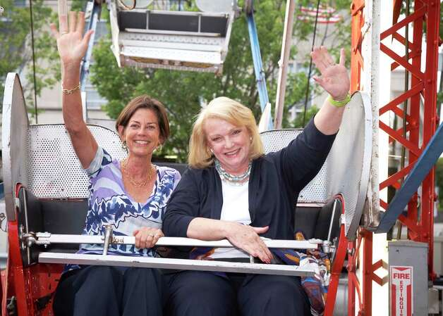 Laurie Host of Greenwich and Jan Dilenschneider of Darien test out the ferris wheel at Family Centers' Dancin' in the Street benefit June 2, 2012. Darien, Conn. Photo: Contributed Photo