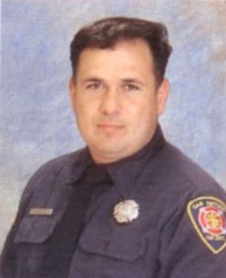 Lt. Richard Bart Olmo, 44, died in a single-vehicle crash in Bandera County  Tuesday morning. A 24-year San Antonio Fire Department veteran, Olmo leaves  behind a wife and two children. Photo: Courtesy