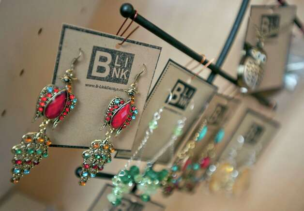 Colorful earrings are among the jewelry for sale at  B. Link. Garcia produces more technical items, such as those involving metalwork, at her home studio. Photo: Darren Abate, FRE