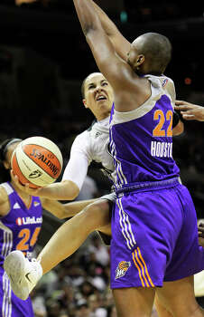 Becky Hammon tries a tough shot in the lane against Charde Houston as the Silver Stars host the Phoenix Mercury at the AT&T Center on July 3, 2012. Photo: Tom Reel, San Antonio Express-News / ©2012 San Antono Express-News