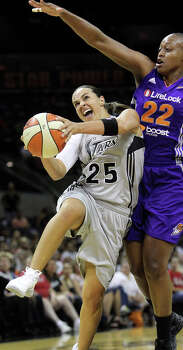 Becky Hammon rolls in for a bucket under Charde Houston as the Silver Stars host the Phoenix Mercury at the AT&T Center on July 3, 2012. Photo: Tom Reel, San Antonio Express-News / ©2012 San Antono Express-News