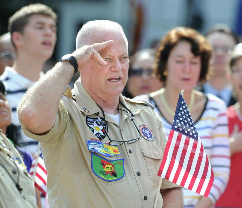 Boy Scout Troop 35 leader Rich Rooney of Greenwich salutes the American flag during the Fourth of July ceremony at Greenwich Town Hall, Wednesday morning, July 4, 2012. Photo: Bob Luckey / Greenwich Time
