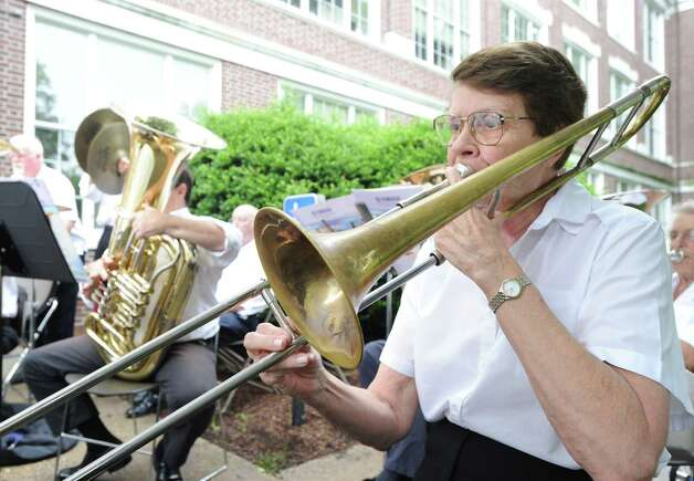 Car Westbrook of the Sound Beach Community Band plays trombone during the Fourth of July ceremony at Greenwich Town Hall, Wednesday morning, July 4, 2012. Photo: Bob Luckey / Greenwich Time