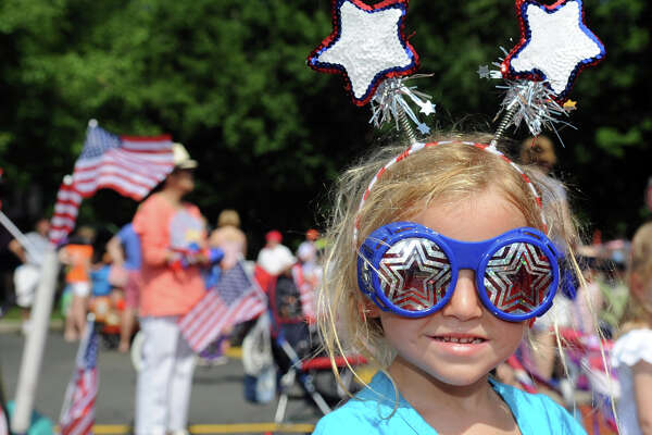Grace Lodge, 3, shows off her patriotic outfit during Wednesday's YWCA Push-n-Pull Parade in Darien on July 4, 2012.