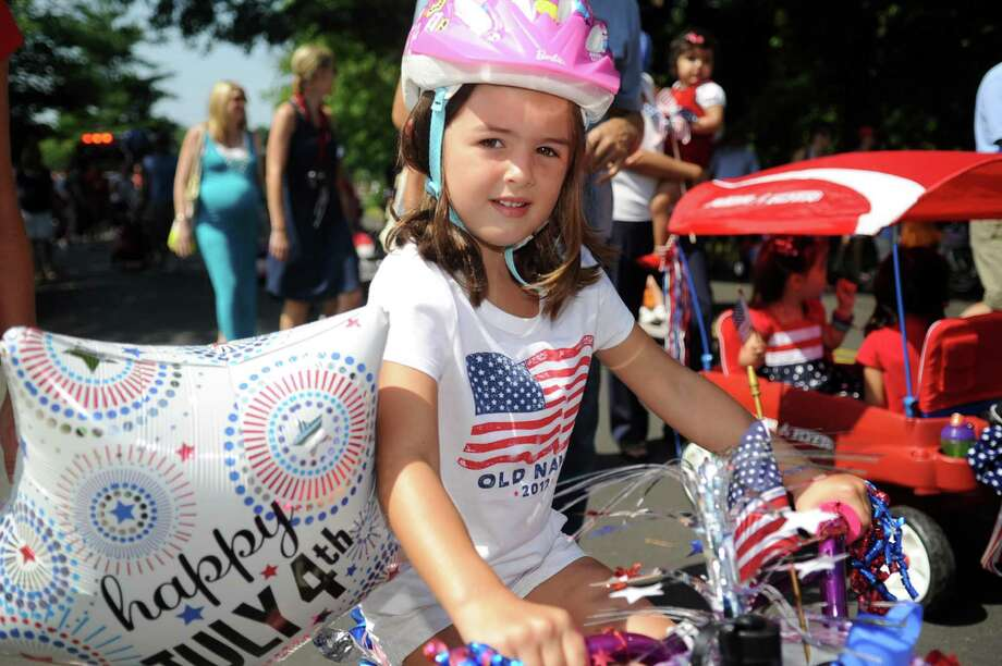 Children and parents walk, ride, and bike in Wednesday's YWCA Push-n-Pull Parade in Darien on July 4, 2012. Photo: Lindsay Niegelberg / Stamford Advocate