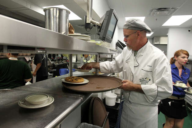 Robert Fleming, owner of the Magnolia Pancake Haus, has opened a new location for his iconic San Antonio restaurant on Huebner road. Fleming works the line and tends to the same duties that the rest of the staff carries out. The restaurant is open from 7:00 a.m. until 2:00 p.m. seven days a week. John Davenport/San Antonio Express-News Photo: San Antonio Express-News